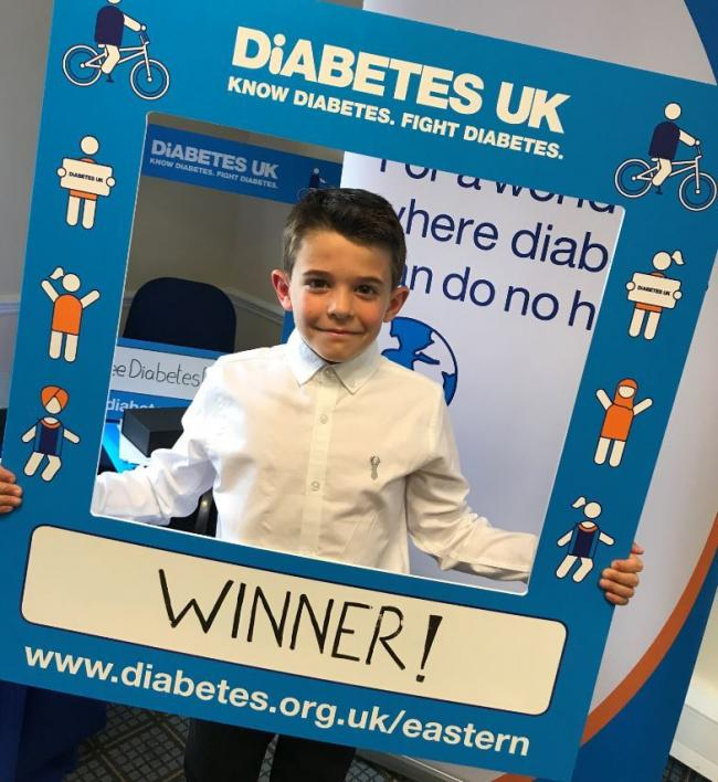 OUTSTANDING CONTRIBUTION: Leo Turner receives his award for helping to inspire others suffering from diabetes