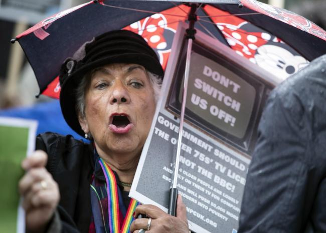 A protestor near BBC Media City in Salford, Greater Manchester, during a demonstration over the broadcaster's decision to axe free TV licences for 3.7 million pensioners. PRESS ASSOCIATION Photo. Picture date: Thursday June 13, 2019. The BBC revealed