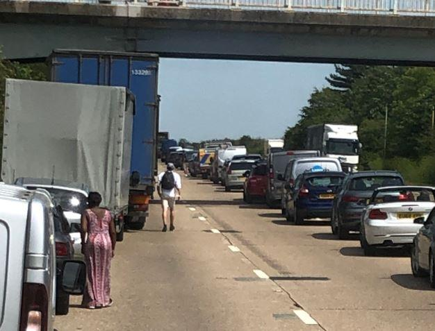 Long queues have formed on the A12