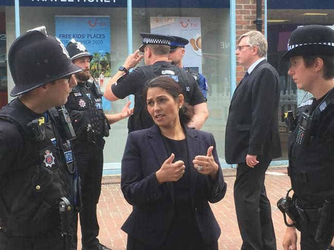 TOUGH TALK: Home Secretary Priti Patel chats with offiers at Witham Grove Centre.