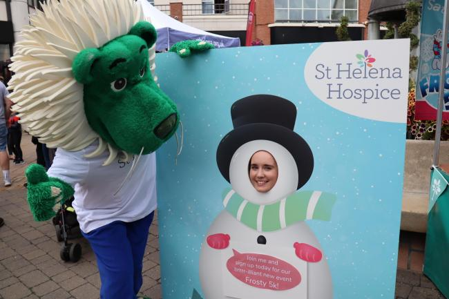 Chilly - •	Dandy the Lion with St Helena Hospice volunteer Abbey Bedford