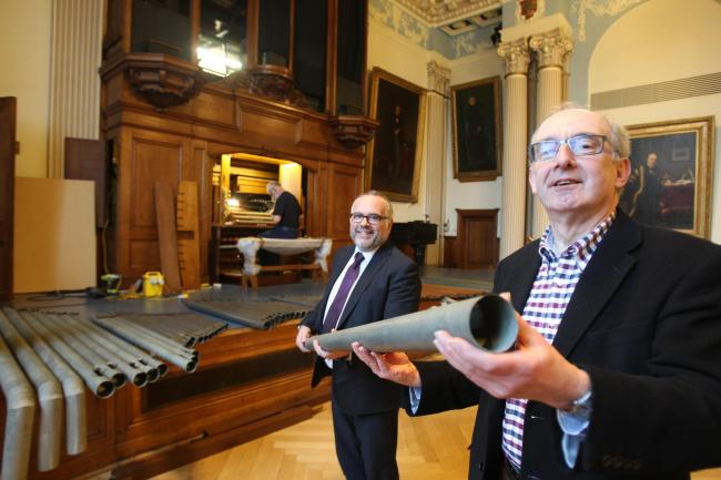 Restored - Colchester councillors Tim Young and Nigel Chapman with the Moot Hall Organ during its restoration
