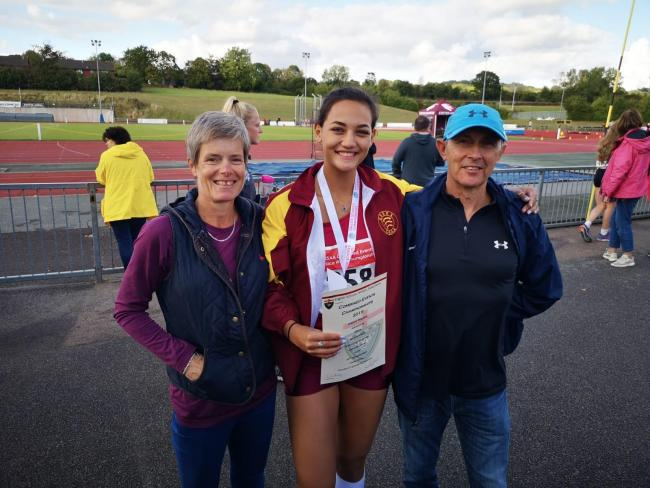 Jessica Hopkins celebrates her second-place finish at the English Schools Combined Events Championships with coaches Steve Mitchell and Sarah Besford