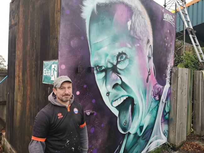 Street artist Gnasher with his finished mural