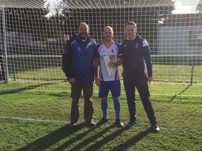 Milestone: FC Clacton's Kyelan Marvell made his 300th appearance for the club in Saturday's 3-2 defeat at home to Godmanchester Rovers. A special presentation took place before the game and he is pictured here with Seasiders co-owner Stephen Andre