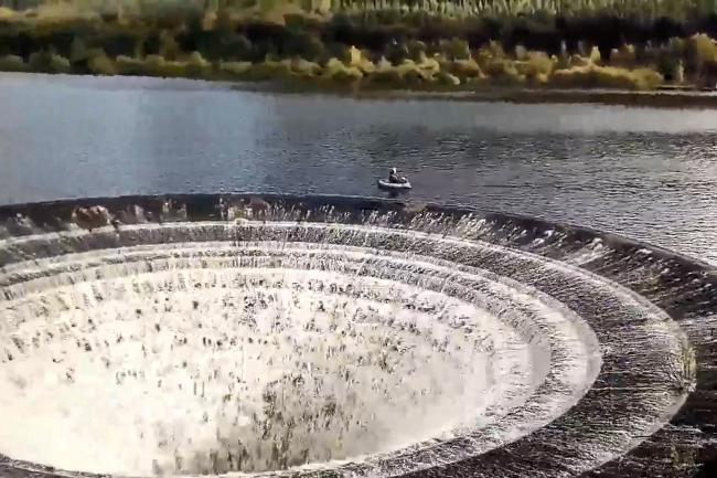 Anglers near a 'plughole' on Ladybower Reservoir