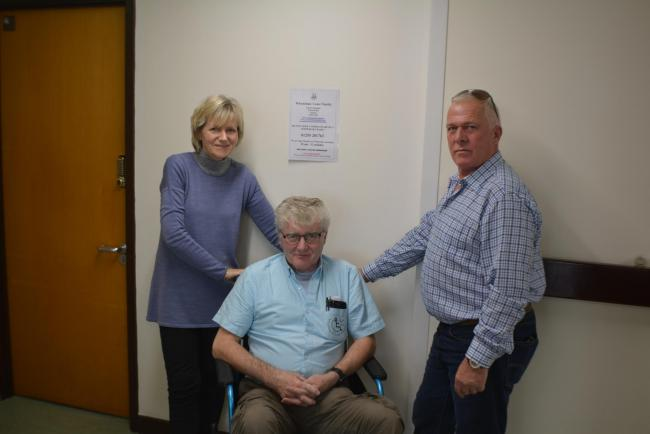 Grateful - Sally Cheves, administrator, with volunteers Mick Lunniss in the wheelchair and Paul Harding