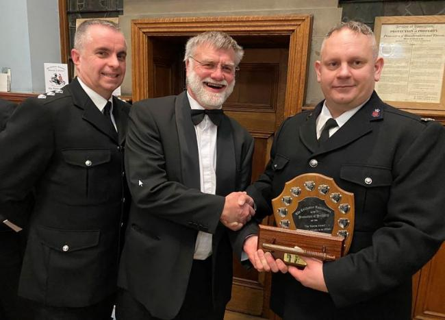 Winner - PC Darrin Patrick with his award from the Colchester Thieves