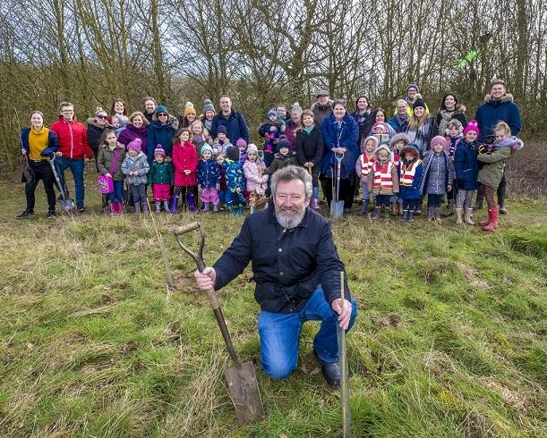 TREE PLANTING: Cllr Simon Walsh helped plant the trees. Photo credit: Paul Starr Photographer