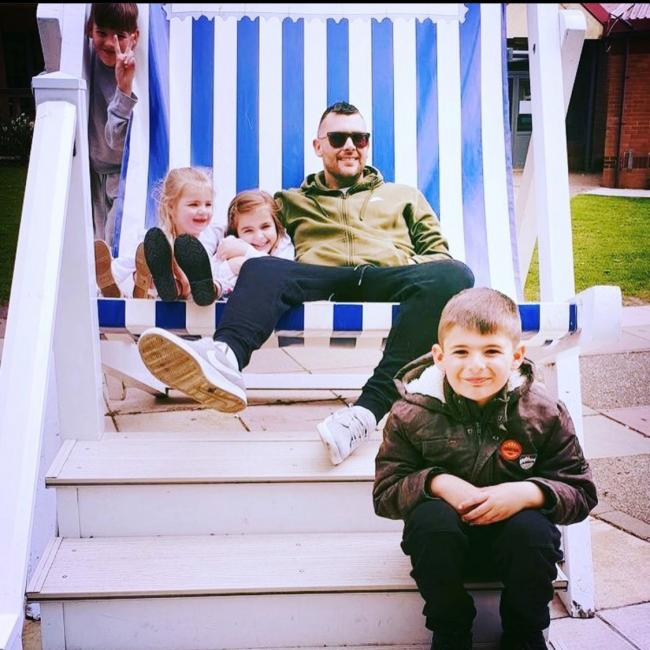 Electrician - Matthew Mulhearn with three of his children