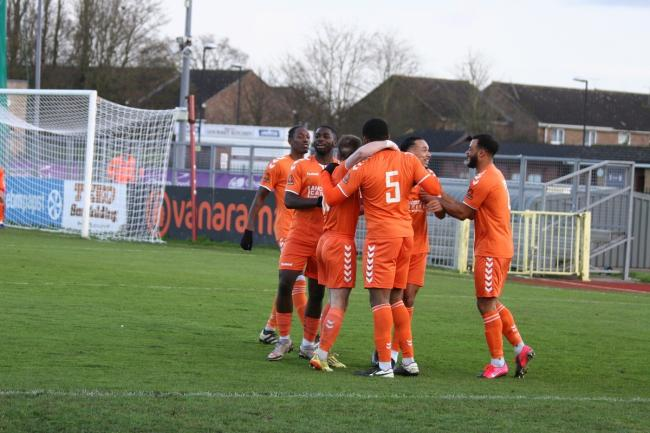 All together now: Braintree Town's players celebrate after Taofiq Olomowewe's goal against Chelmsford City, on Saturday. Picture: JON WEAVER