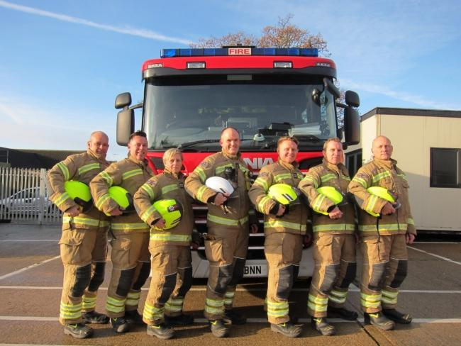 Much-loved - Aston Everett (second from right), pictured with his colleagues from the Clacton Fire Station, who has tragically died aged 54