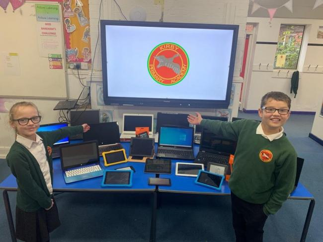 DIGITAL AGE: Kirby Primary School students Ariana and Logan are delighted with their new gadgets