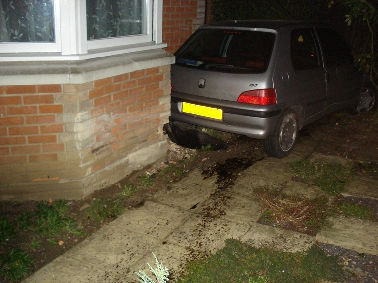 Car ploughed through fence and into Witham home