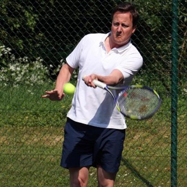 Prime Minister David Cameron, a keen tennis player, wants to lose weight
