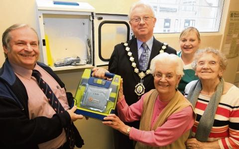 Witham: Celebrations as defibrillator installed at last