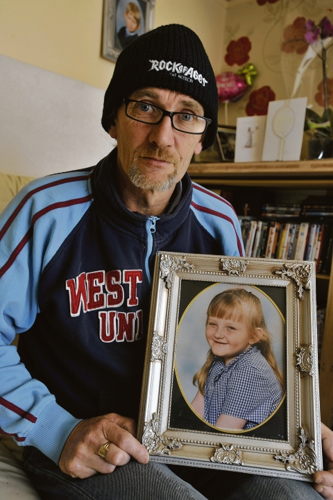 Broken-hearted – Darren Coote with a picture of his daughter Chelsea