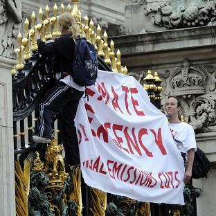 Protesters from the Climate Siren group scaled the gates of Buckingham Palace
