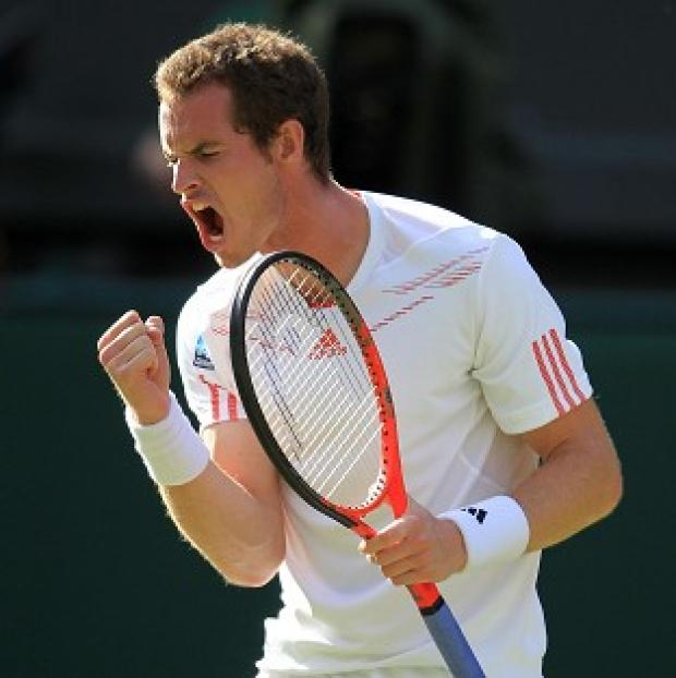 Andy Murray celebrates defeating Croatia's Ivo Karlovic at Wimbledon