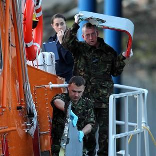 Plane wreckage is taken off Buckie lifeboat following an incident in which two RAF Tornados crashed off the coast of Scotland