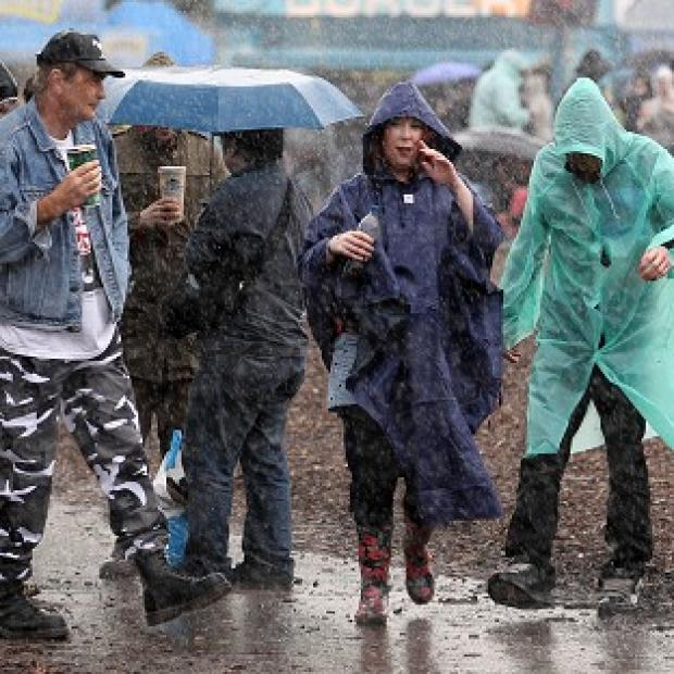 Festival-goers braved the rain at the Hard Rock Calling music festival in Hyde Park, London