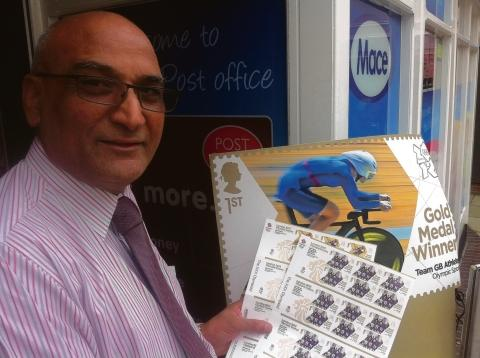 Braintree and Witham Times: Postmaster Jake Singh with the limited edition Olympic stamps