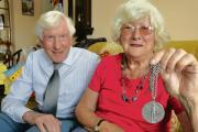 June Guild – with husband        John and her commemorative medal. Inset: A close-up