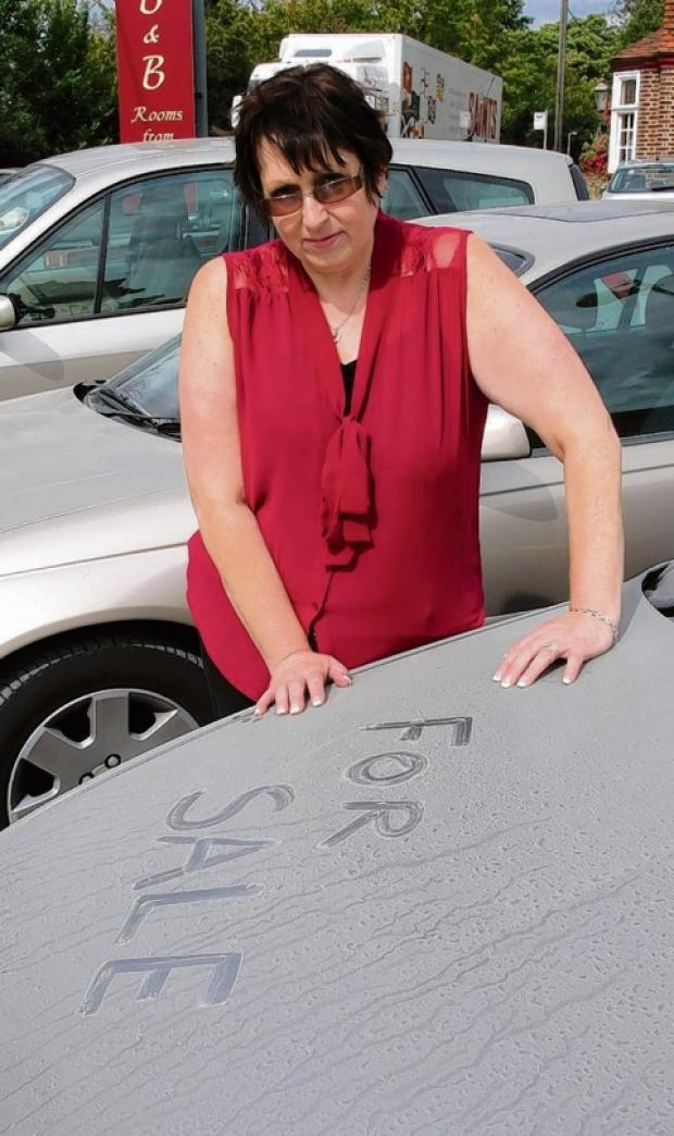 Jackie Reading, of High Garrett Car Sales, with one of the dusty cars