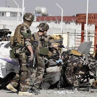 French soldiers at the scene of the suicide bombing in Kabul, Afghanistan (AP)