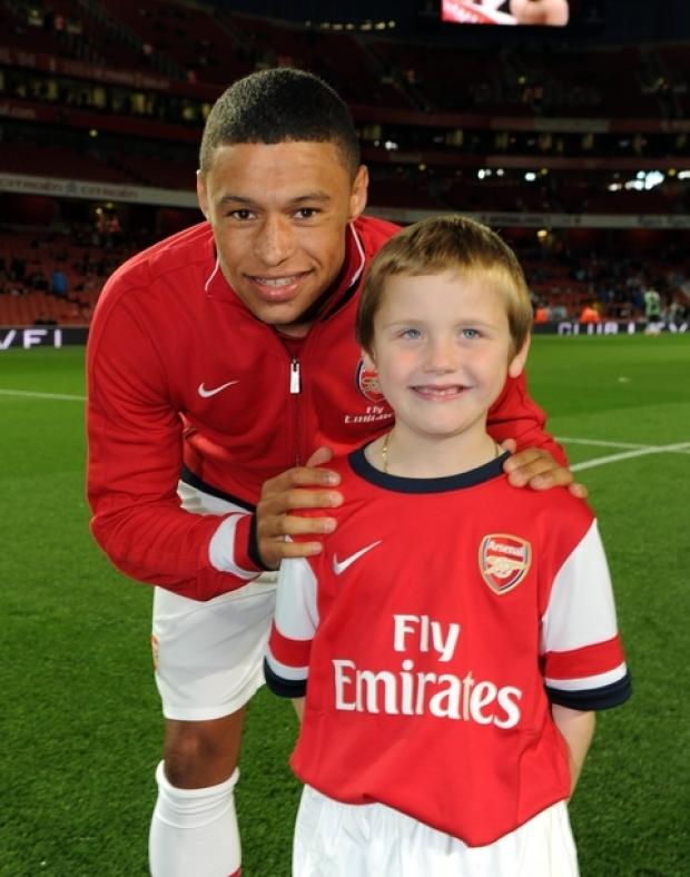 Braintree: Young fan leads out players at Arsenal match