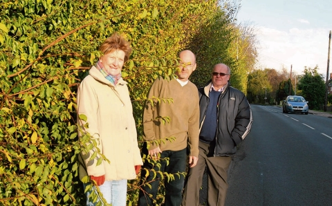 Councillors Jackie Nesbitt, James Abbott and Bob Wright at the bus stop