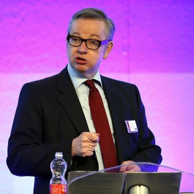 Education Secretary Michael Gove is aiming to encourage top graduates to train as social workers