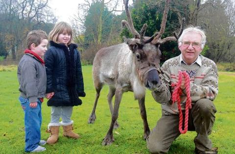 Lily and Shay Williamson with Cliff Collins and one of his reindeer