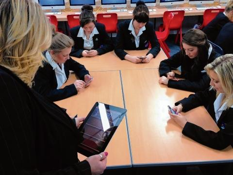 Pupils using iPads and iPods