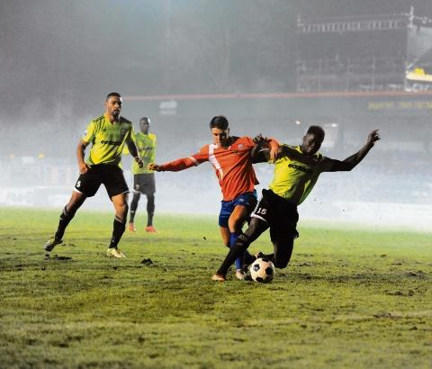 Braintree and Witham Times: Dan Holman tussles with the Forest Green defence. Picture: NEIL DADY