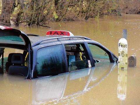 Braintree and Witham Times: The submerged taxi. Photo by Paul Harrison