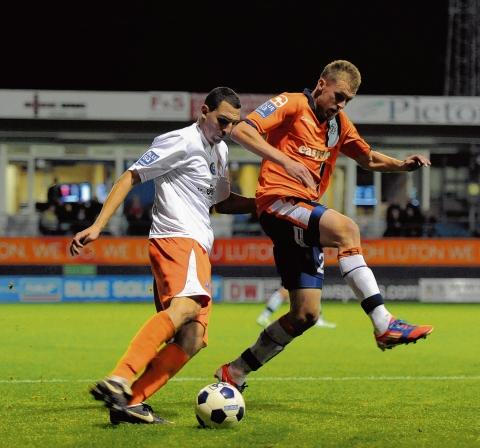 Dan Walker (right) in action for Luton when they played Braintree earlier in the season. Picture: NEIL DADY