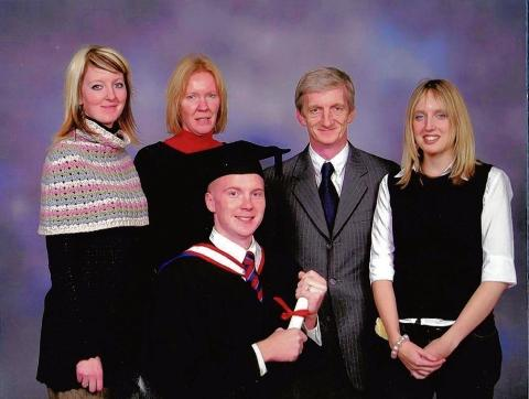 Simon Brind (pictured second from right) with his family