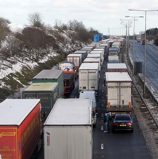 Lorries queue for the Channel Tunnel on the M20 near Folkestone in Kent
