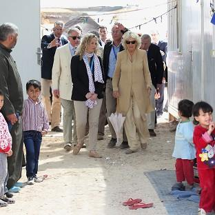 The Prince of Wales and Duchess of Cornwall meet Syrian refugees in the King Abdullah Refugee Camp in Amman, Jordan