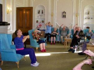 Elderly get in the swing of armchair zumba