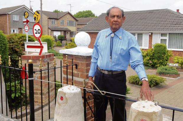 Pensioner who put up bollards to protect his home from cars writes to Queen in attempt to sway council
