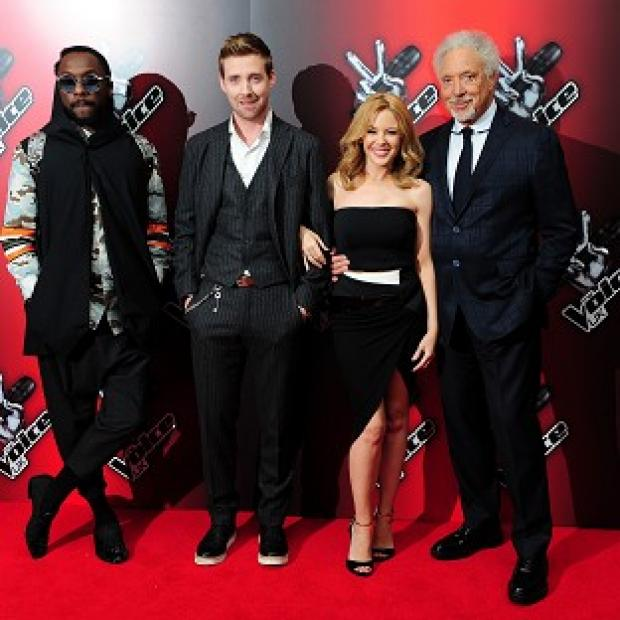 Braintree and Witham Times: At the launch of BBC talent show The Voice are coahces (from left) Will.i.am, Ricky Wilson, Kylie Minogue and Sir Tom Jones