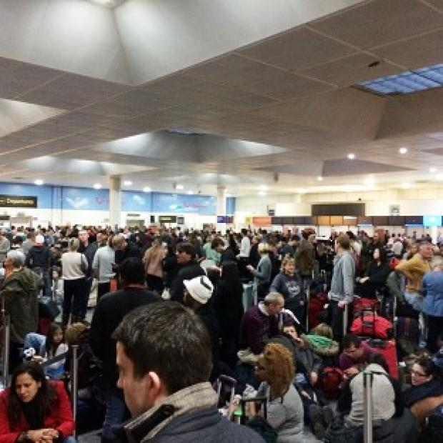 Braintree and Witham Times: Passengers waiting at the North Terminal at Gatwick as flights were cancelled due to bad weather (Daniel Cawthorne).