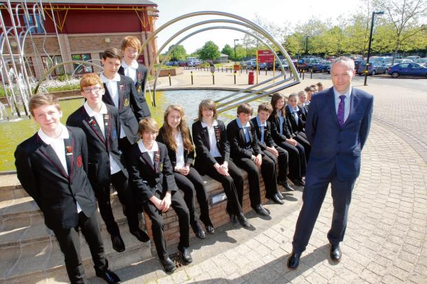Headteacher Steven Clark with pupils at Tabor Academy in Braintree. Mr Clark is leaving the school to take up a new role.