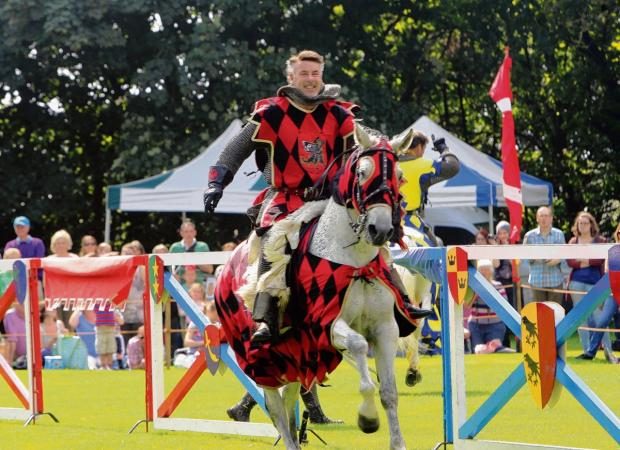 A knight prepares for battle during a medieval day at Hedingham Castle last year