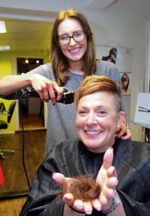 Julie Cordery having her head shaved by Jessica Brown at Headmasters hairdressers.