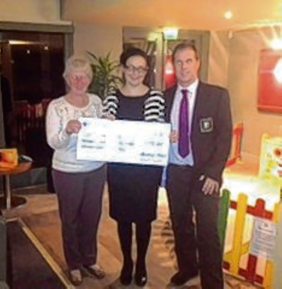 Lesley Sherer, Gary Brown and Claire Reeve with the cheque for £13,173