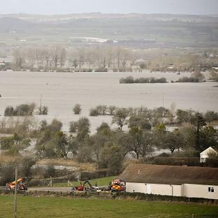 Braintree and Witham Times: Flood water covers part of the Somerset Levels near Burrowbridge
