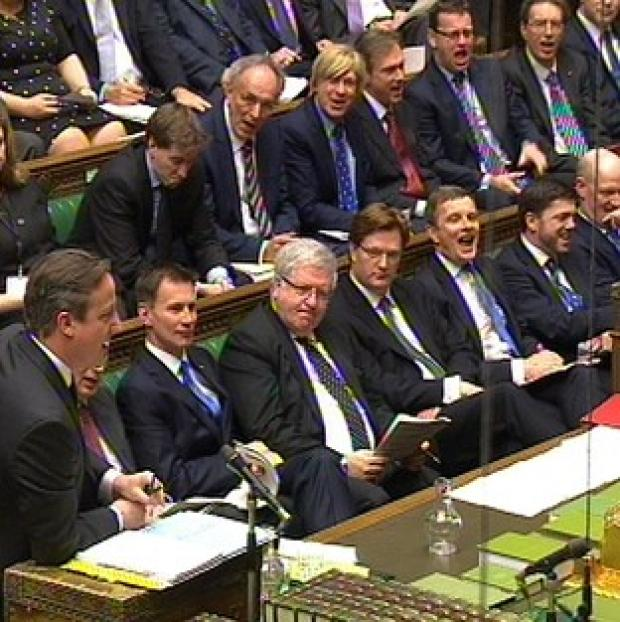 Braintree and Witham Times: A view of the Government front bench as David Cameron speaks during Prime Minister's Questions.